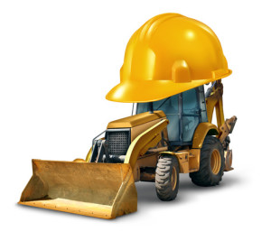 Construction work safety concept with a Bulldozer truck as a yellow generic excavator wearing a giant hard hat to build roads homes and clear the landscape with heavy dangerous machinery on a white background.